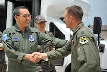 Lt. Col. Luke Lokowich, 5th Reconnaissance Squadron commander, greets Republic of Korea air force Lt. Gen. Jae-Bock Park, ROK Air Force Operations Command commander, during a visit to the squadron at Osan Air Base, ROK, June 11, 2014. The tour was tailored to showcase Osan's mission and various capabilities. (U.S. Air Force photo/Airman 1st Class Ashley J .Thum)
