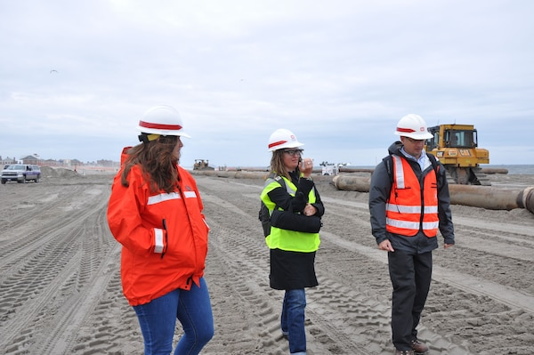 Representatives from the U.S. Army Corps of Engineers, New York District, conduct a walk-through of the project site with German reporter Petrina Engelke. The Corps of Engineers is currently in the middle of placing an estimated 3.5M cubic yards of sand onto the Rockaway coastline to improve flood risk reduction measures for future storms.
