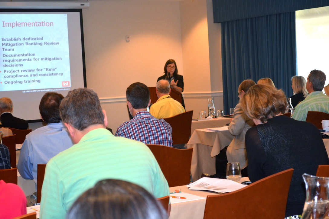 Debbie Wegmann, chief of Regulatory Division's Special Projects and Enforcement Branch, discusses mitigation banking at a two-day workshop in Jacksonville, hosted by the Florida Association of Mitigation Banking.