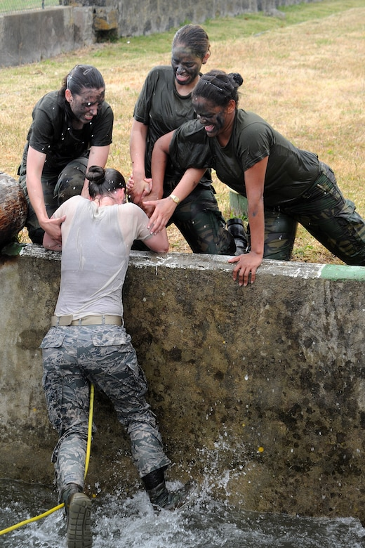 U.S. and Portuguese airmen compete in the Defender Challenge May 30, 2014, at Lajes Field, Azores, Portugal.  The Portuguese air force held the challenge in celebration of the 59th anniversary of the Air Police Squadron. The challenge tested the airmen's strength, endurance and ability to work together to accomplish tasks. (U.S. Air Force photo/Guido Melo)