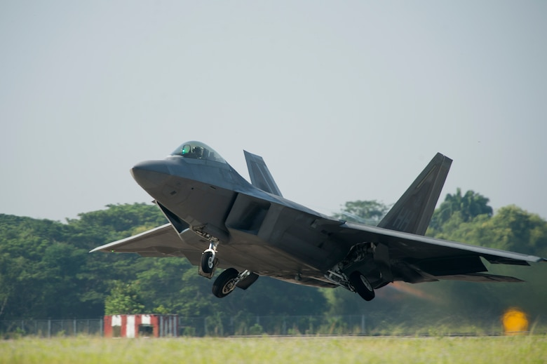 An F-22 Raptor takes off for an exercise sortie June 10, 2014, in support of Cope Taufan 14 at Royal Malaysian air force P.U. Butterworth, Malaysia. Cope Taufan is a biennial large force employment exercise taking place June 9 to 20. This marks the F-22's first deployment to Southeast Asia. The F-22 is from the 154th Wing, Joint Base Pearl Harbor-Hickam, Hawaii. (U.S. Air Force photo/Tech. Sgt. Jason Robertson)