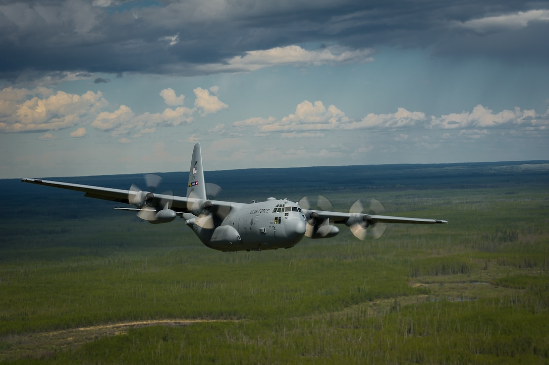 A C-130 Hercules aircraft maneuvers to avoid simulated surface-to-air threats during exercise Maple Flag 47, June 2, 2014, near Canadian Forces Base Cold Lake, Alberta. Maple Flag is an international exercise designed to enhance the interoperability of C-130 aircraft crews, maintainers and support specialists in a simulated combat environment. The C-130 is assigned to the 94th Airlift Wing at Dobbins Air Reserve Station, Ga. (U.S. Air Force photo/Master Sgt. John R. Nimmo Sr.)