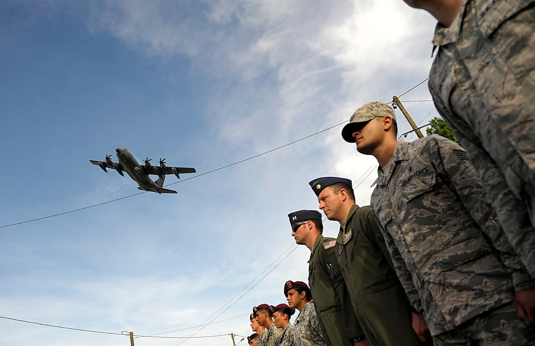 A C-130J Super Hercules aircraft flies over a formation of Airmen as they participate in a ceremony to remember veterans of World War II on the 70th anniversary of D-Day June 6, 2014, in Picauville, France. The event was one of several commemorations of D-Day operations conducted by Allied forces. The morning of June 6, 1944, Allied forces conducted a massive airborne assault and amphibious landing in the Normandy region of France. The invasion marked the beginning of the final phase of World War II in Europe, which ended with the surrender of Germany the following May. (U.S. Air Force photo/Staff Sgt. Sara Keller)