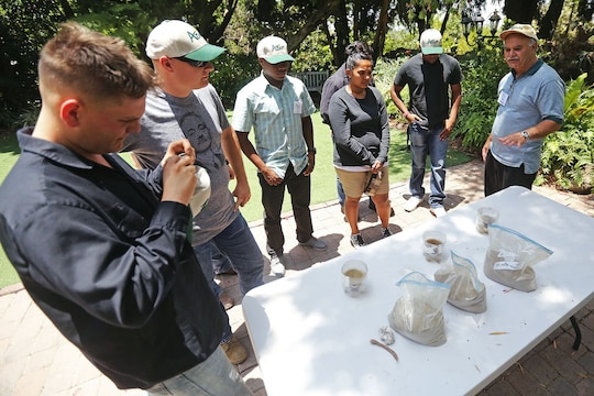 Marines with 1st Civil Affairs Group, Marine Forces Reserve, watch a demonstration of how water interacts with soil at the San Diego Botanical Gardens in Encinitas, Calif., June 10, 2014. The demonstration was part of the Agricultural Development for Armed Forces Pre-Deployment Training preparing the Marines to deploy to Southeast Asia.