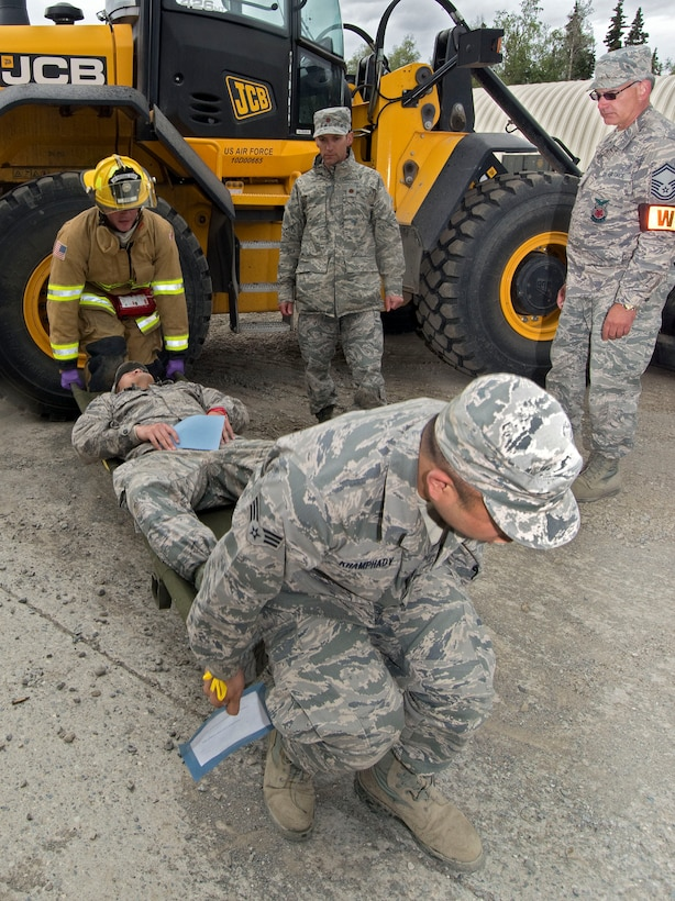 JOINT BASE ELMENDORF-RICHARDSON, Alaska-- Firefighters and other 176 Civil Engineering Squadron members practice rescue techniques during an exercise here at Camp Mad Bull here June 9, 2014. The 176 Mission Support Group and the 176 Medical Group participated as part of Polar Guardian 14-2. (U.S. Air National Guard photo by Capt. John Callahan/ Released)