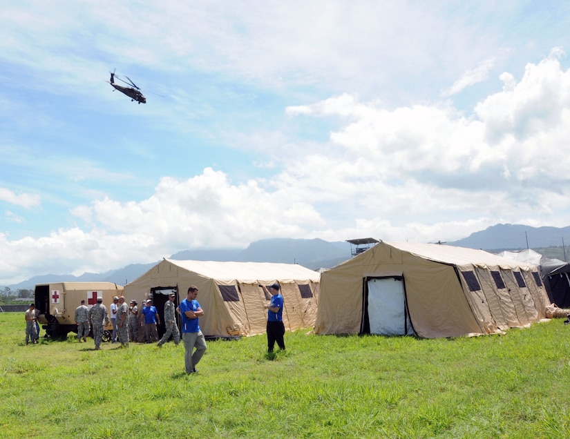 A UH-60 Blackhawk MEDEVAC helicopter takes off in simulated patient air evacuation during a exercise at Soto Cano Air Base, Honduras.  In preparation for the 2014 hurricane season, the Joint Task Force-Bravo Medical Element (MEDEL) conducted a humanitarian assistance/disaster response (HA/DR) exercise at Soto Cano Air Base June 12, 2014.  The MEDEL's mission was to establish a forward medical treatment operation capable of providing triage, primary care, surgical capabilities, patient holding and evacuation.  As part of this exercise, a suite of mobile technology applications that run on smartphones and tablets were used to enhance the capabilities of the unit: Global MedAid, Medical Application of Speech Translation (MAST) and GeoSHAPE.  (Photo by U. S. Air National Guard Capt. Steven Stubbs)