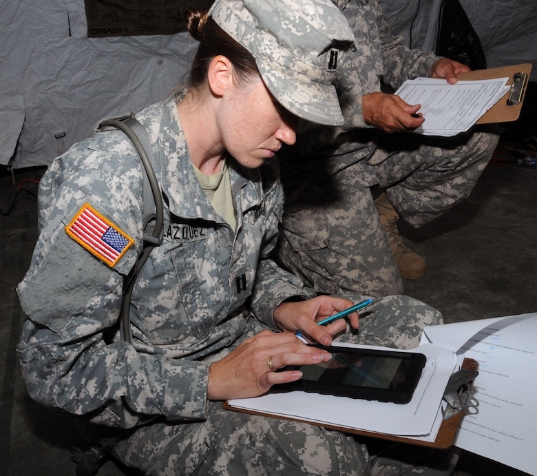 U. S. Army Capt. Erin Velazquez studies a route recon on a tablet using the GeoSHAPE program.  In preparation for the 2014 hurricane season, the Joint Task Force-Bravo Medical Element (MEDEL) conducted a humanitarian assistance/disaster response (HA/DR) exercise at Soto Cano Air Base, Honduras June 12, 2014.  The MEDEL's mission was to establish a forward medical treatment operation capable of providing triage, primary care, surgical capabilities, patient holding and evacuation.  As part of this exercise, a suite of mobile technology applications that run on smartphones and tablets were used to enhance the capabilities of the unit: Global MedAid, Medical Application of Speech Translation (MAST) and GeoSHAPE.  (Photo by U. S. Air National Guard Capt. Steven Stubbs)