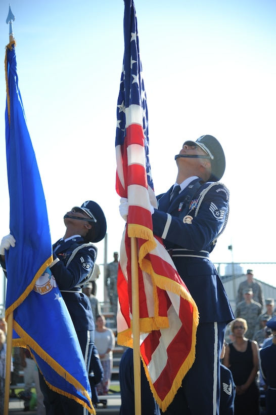 Members of the Keesler Honor Guard post the colors during a re-dedication ceremony honoring the late Airman 1st Class Antoine Holt June 12, 2014, in front of Avery Manor at Keesler Air Force Base, Miss.  Holt, a former student in the 334th TRS, lost his life April 10, 2004 while at Balad Air Base, Iraq, when his tent was hit by a mortar attack. (U.S. Air Force photo by Kemberly Groue)