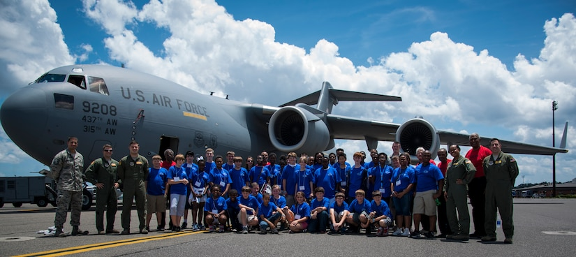 Students from the Take Flight! Aviation Camp, Tuskegee Airmen and C-17 Globemaster III crewmembers, pose for a group photo June 12, 2014, on the flight line at Joint Base Charleston, S.C. The purpose of the camp is to inspire students to pursue careers in aviation. (U.S. Air Force photo/ Airman 1st Class Clayton Cupit)