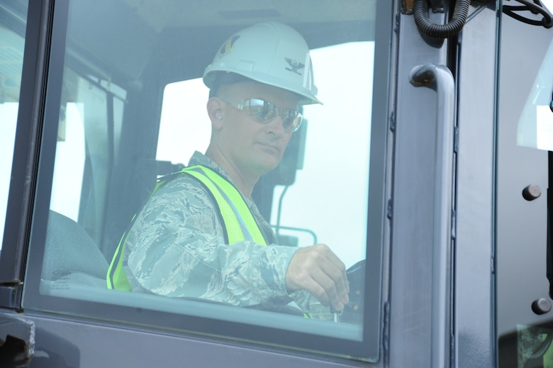 Col. Bill Knight, 11th Wing/Joint Base Andrews commander, operates a construction vehicle at the site currently in development for Heritage Park near the main entrance at Joint Base Andrews, Md., June 5, 2014. The park will be a new landmark on base to celebrate military heritage and culture. (U. S. Air Force photo/Airman 1st Class Joshua R. M. Dewberry)