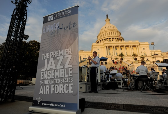 The Air Force Strings with The Airmen of Note present a D-Day 70th Anniversary Big Band Salute on the steps of The U.S. Capitol Building, Washington, D.C., June 10, 2014. The Air Force Strings and Airman of Note, both groups members of The U.S. Air Force Band, will be performing free outdoor concerts at the capitol steps every Tuesday evening throughout the summer. (U.S. Air Force photo/Senior Airman Nesha Humes)
