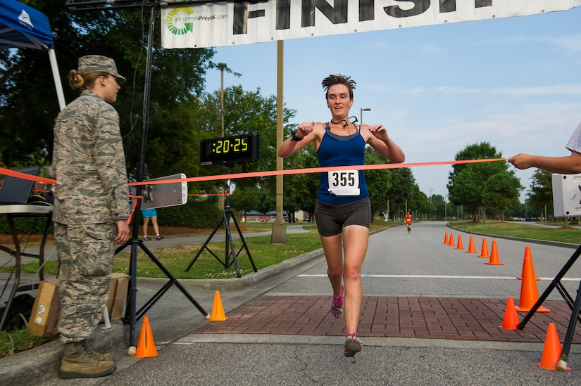 Ensign Jennifer Oblinger, Naval Nuclear Power Training Command instructor, finishes as the first place female during the Run the Runway 5K, June 14, 2014, at Joint Base Charleston, S.C. The event fostered relationships with members of the surrounding community, while raising awareness about Lou Gehrig's disease and honoring Brig. Gen. Thomas Mikolajcik, who succumbed to the disease in 2010. Oblinger finished with a time of 20:27. (U.S. Air Force photo/Senior Airman George Goslin)