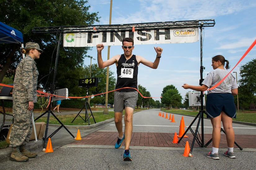 Michael Seekings, Charleston City Councilman, crosses the finish line in first place during the Run the Runway 5K, June 14, 2014, at Joint Base Charleston, S.C. The event fostered relationships with members of the surrounding community, while raising awareness about Lou Gehrig's disease and honoring Brig. Gen. Thomas Mikolajcik, who succumbed to the disease in 2010. Seekings finished with a time of 18:52. (U.S. Air Force photo/Senior Airman George Goslin)