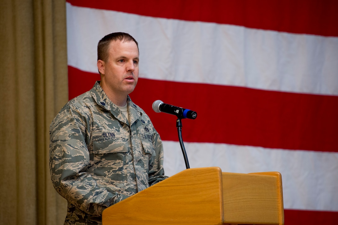 U.S. Air Force Lt. Col. Jason Glynn, 386th Expeditionary Civil Engineer Squadron commander, speaks to Airmen during a change of command ceremony June 11, 2014 at the Rock Theater at an undisclosed location in Southwest Asia. Glynn comes from Peterson Air Force Base, Colorado where he was the legislative affairs officer for the North American Aerospace Defense Command and United States Northern Command. (U.S. Air Force photo by Staff Sgt. Jeremy Bowcock)