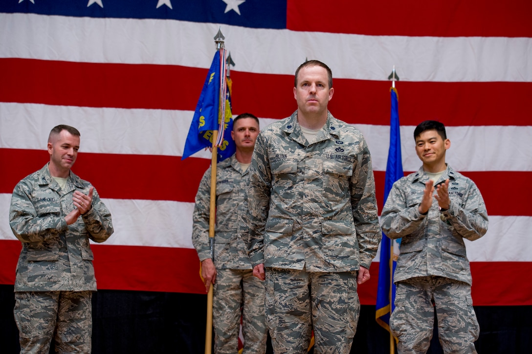 U.S. Air Force Lt. Col. Jason Glynn stands before his Airmen after assuming command of the 386th Expeditionary Civil Engineer Squadron June 11, 2014 at the Rock Theater at an undisclosed location in Southwest Asia. Glynn comes from Peterson Air Force Base, Colorado where he was the legislative affairs officer for the North American Aerospace Defense Command and U.S. Northern Command. (U.S. Air Force photo by Staff Sgt. Jeremy Bowcock)