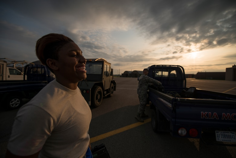 Senior Airman Kayla Dale, a 51st Maintenance Squadron non-destructive inspector, walks back to her vehicle after completing an inspection June 4, 2014, at Osan Air Base, Republic of Korea. A native of Chicago, Dale said she loves her job because it allows her to use her experience in math and science while working. (U.S. Air Force photo by Staff Sgt. Jake Barreiro)
