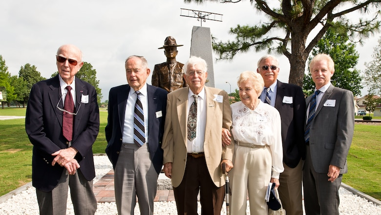 "From left: Retired pilots Col. James ""Pat"" Pool, Lt. Col. John Beard, and Lt. Col. Charles Fisk and family members, stand in front of the new enlisted pilot monument at Maxwell-Gunter Air Force Base, June 9, 2014. The monument honored the nearly 3,000 enlisted sergeant pilots, including Pool, Beard and Fisk, who served in the military from 1912-1957. (U.S. Air Force photo by Donna Burnett)"