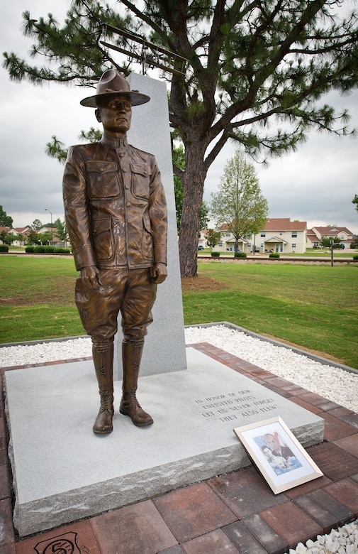 A new monument honoring the nearly 3,000 enlisted sergeant pilots who served from 1912-1957 was unveiled during a ceromony June 9, 2014, at the Enlisted Heritage Hall at Maxwell-Gunter Air Force Base. The monument depicts Cpl. Vernon L. Burge, the first enlisted pilot in military aviation, and recognizes the acomplishments of the enlisted fliers who came after him. (U.S. Air Force photo by Donna Burnett)