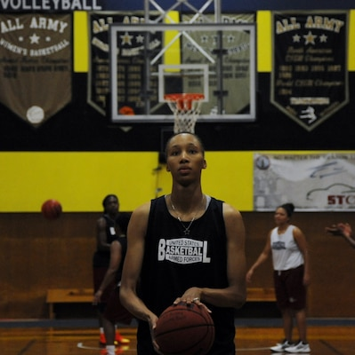 Spc. Danielle Salley, 20th Engineer Brigade, Fort Bragg, N.C., prepares for a free throw at practice June 9 on Fort Indiantown Gap, Pa. At six feet, four inches tall, Salley plays center. (U.S. Army National Guard photo by Maj. Angela King-Sweigart/Released)