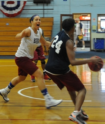 Team captain, Army Capt. Caitlin Chiaramonte, judge advocate for the 18th Fires Brigade, 82nd Airborne Division, Fort Bragg, N.C., plays defense during practice June 9 on Fort Indiantown Gap, Pa. Three members of this year's Women's Armed Forces Basketball team are stationed at Fort Bragg. (U.S. Army National Guard photo by Maj. Angela King-Sweigart/Released)