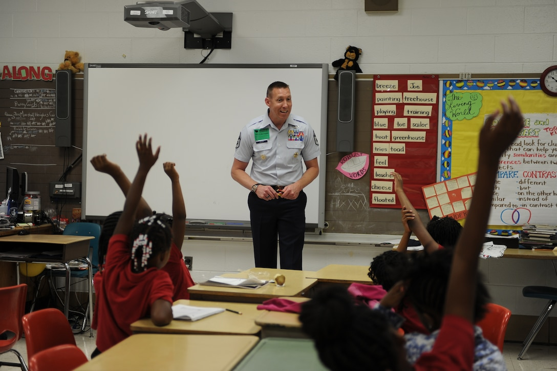 Master Sgt. Philip Skopp answers questions in a fifth-grade classroom at Malcolm X Elementary School during Career Day.