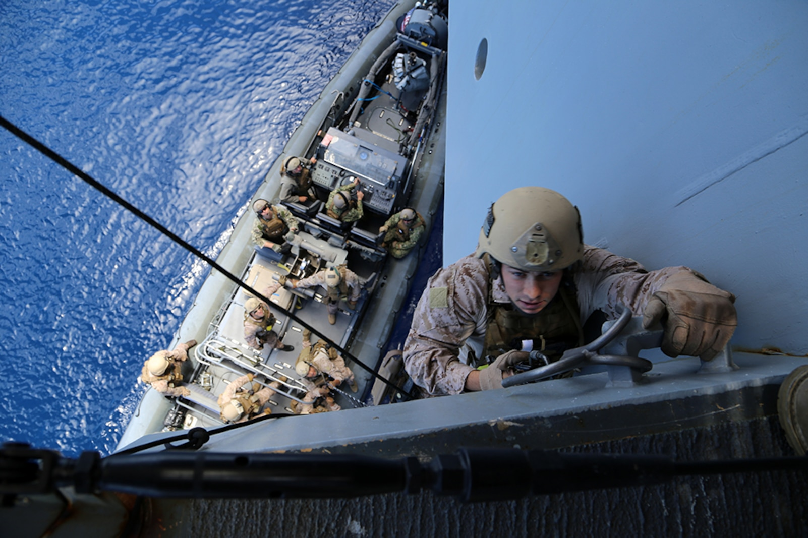 A Marine with the Force Reconnaissance Detachment, 11th Marine Expeditionary Unit, climbs up the USS San Diego on a caving ladder as part of an approach, hook and climb exercise conducted during Certification Exercise (CERTEX) off the coast of Southern California, June 13, 2014. The 11th MEU and Amphibious Squadron 5 team conduct CERTEX to hone mission-essential tasks, execute specified MEU and Amphibious Ready Group operations, and certify the foundation of a cohesive warfighting team for exercises and operations they may encounter in their upcoming deployment. (U.S. Marine Corps photo by Gunnery Sgt. Rome M. Lazarus/Released)