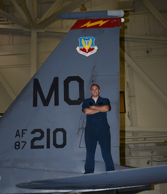 Senior Airman Wes Atkins, 366th Equipment Maintenance Squadron crew chief, stands on a F-15E Strike Eagle June 6, 2014, at Mountain Home Air Force Base, Idaho. Atkins assisted Idaho state police with a major accident and attruibutes his quick thinking to the risk-management training members receive during the 101 Critical Days of Summer. He urges everyone to be safe when driving on the interstate. (U.S. Air Force photo by Senior Airman Benjamin Sutton/Released)