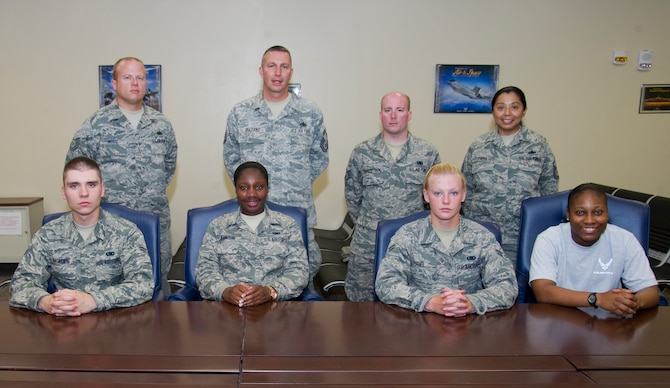 The 325th Logistics Readiness Squadron takes a group photo June 6. Top row from left to right: Tech. Sgt. Travis Moss, Senior Master Sgt. Frank Graziano, Staff Sgt. Michael Sprinsteen. Bottom row from left to right: Airman 1st Class Anton Nasedkin, Airman 1st Class Beatrice Atkinson, Airman 1st Class Megan Frei, Airman 1st Class Asia Bell. (U.S. Air Force photo by Airman 1st Class Sergio A. Gamboa)