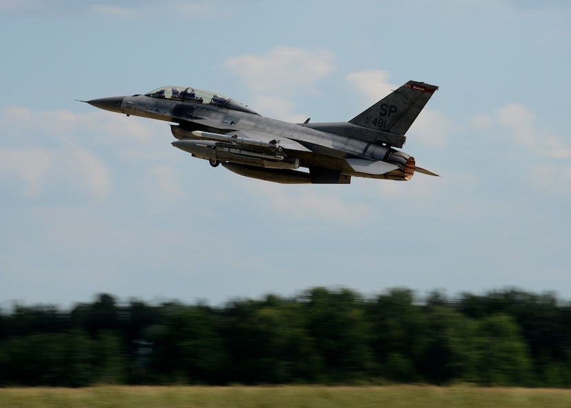 A U.S. Air Force F-16 Fighting Falcon fighter aircraft from the 52nd Fighter Wing, Spangdahlem Air Base, Germany, takes off from Lask Air Base, Poland, June 12, 2014. There are 18 aircraft participating in multinational Polish-led Exercise EAGLE TALON and U.S. Navy-led BALTOPS 14 in addition to U.S. Aviation Detachment Rotation 14-3. U.S. Air Force pilots flew with other pilots from multiple countries to increase readiness for real-world operations and enhance interoperability between NATO forces. (U.S. Air Force photo by Airman 1st Class Kyle Gese/Released)