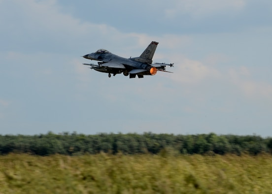 A U.S. Air Force F-16 Fighting Falcon fighter aircraft from the 52nd Fighter Wing, Spangdahlem Air Base, Germany, takes off from Lask Air Base, Poland, June 12, 2014. The U.S. pilots trained with their NATO partners during multinational Polish-led Exercise EAGLE TALON and U.S. Navy-led BALTOPS 14 in addition to U.S. Aviation Detachment Rotation 14-3. Exercises such as these help develop and improve a ready air force between NATO partners for future operations. (U.S. Air Force photo by Airman 1st Class Kyle Gese/Released)
