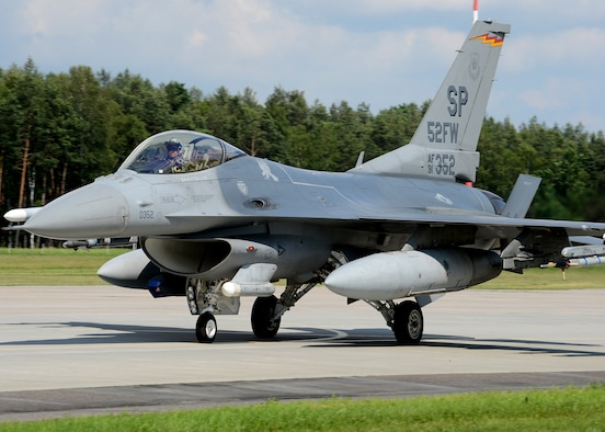 A U.S. Air Force F-16 Fighting Falcon fighter aircraft from the 52nd Fighter Wing, Spangdahlem Air Base, Germany, taxies at Lask Air Base, Poland, June 12, 2014. There are 18 aircraft participating in multinational Polish-led Exercise EAGLE TALON and U.S. Navy-led BALTOPS 14 in addition to U.S. Aviation Detachment Rotation 14-3. U.S. Air Force pilots flew with other pilots from multiple countries to increase readiness for real-world operations and enhance interoperability between NATO forces. (U.S. Air Force photo by Airman 1st Class Kyle Gese/Released)