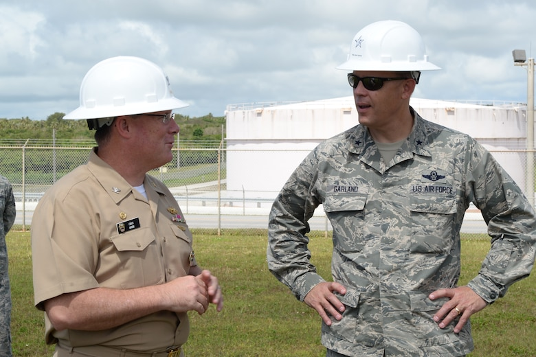 U.S. Air Force Brig. Gen. Steven Garland discusses the start of a new fuel pipeline project with U.S. Navy Capt. Christopher Bower, Defense Logistics Agency Energy Pacific commander June 6, 2014 on Andersen Air Force Base, Guam. Coordination for the project began 10 years ago and the joint team of DLA, Joint Region Marianas and other defense supporting agencies cleared several administrative hurdles to allow construction to begin on a $62 million, 15.7 mile fuel pipeline. (U.S. Air Force photo by Tech. Sgt. Zachary Wilson/Released)