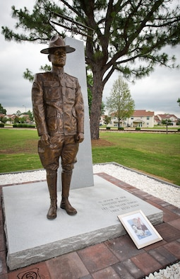 A monument honoring the nearly 3,000 enlisted sergeant pilots who served from 1912-1957 was unveiled during a ceremony June 9, 2014, at the Enlisted Heritage Hall at Maxwell-Gunter Air Force Base. The monument depicts Cpl. Vernon L. Burge, the first enlisted pilot in military aviation, and recognizes the accomplishments of the enlisted fliers who came after him. More than a century after Burge, two Air Force master sergeants became the first enlisted Airmen to fly and complete their own solo flights in a DA-20 Datana, Nov. 3, 2016, part of their required training to become RQ-4 Global Hawk pilots. (U.S. Air Force photo by Donna Burnett)