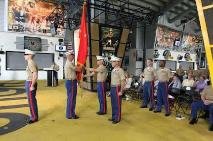 Maj. John M. Hunt takes the organization colors from Sgt, Maj. Adam E. Fraser, recruiting station sergeant major, during the Change of Command ceremony at Heinz Field, June 13. Hunt would go on to pass the colors to the incoming commanding officer symbolizing the relinquishing of command.