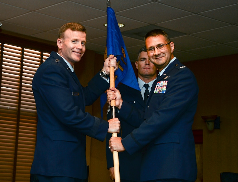 Lt. Gen. Tod Wolters, Commander 12th Air Force (Air Forces Southern) recieves the squadron guideon from Col. Jonathan VanNoord during the 612th Theater Operations Group Change of Command Ceremony on Davis-Monthan AFB, Ariz., June 17, 2014.  VanNoord relinquished command of the 612 TOG to Col. James Sheedy. (U.S. Air Force photo by Tech. Sgt. Heather R. Redman/Released)