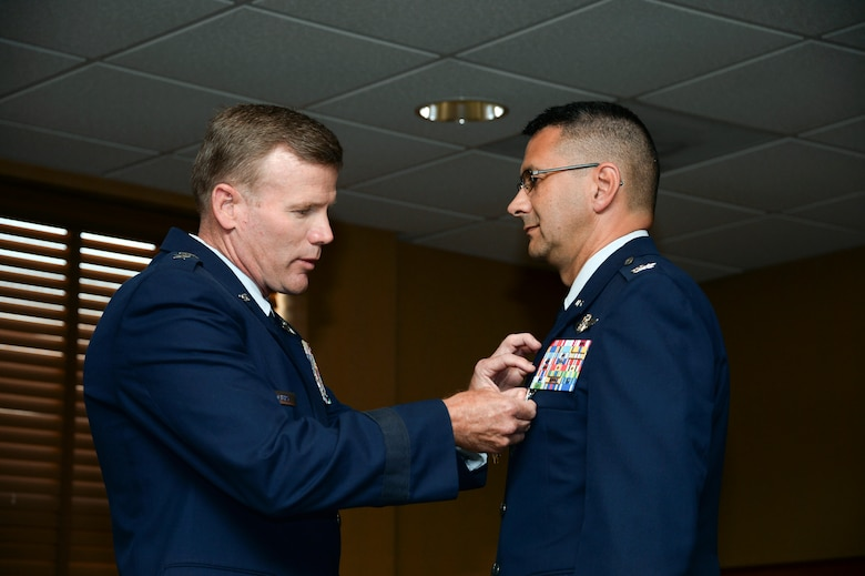 Lt. Gen. Tod Wolters, Commander 12th Air Force (Air Forces Southern) presents Col. Jonathan VanNoord the Legion of Merit during the 612th Theater Operations Group Change of Command Ceremony on Davis-Monthan AFB, Ariz., June 17, 2014.  VanNoord relinquished command of the 612 TOG to Col. James Sheedy. (U.S. Air Force photo by Tech. Sgt. Heather R. Redman/Released)