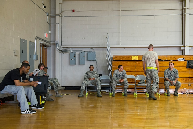 Potential blood donors wait for their chance to give blood at the Air Base gym, June 12, 2014, at Joint Base Charleston, S.C. Members of JB Charleston had the opportunity to donate blood with the help of the American Red Cross, which utilizes volunteers to aid those in need during emergency situations. (U.S. Air Force photo/Senior Airman George Goslin)
