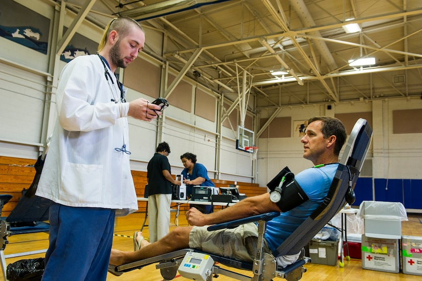 A member of the American Red Cross prepares John Lackey, 628th Security Forces Squadron police officer, to donate blood, at the Air Base Gym, June 12, 2014, at Joint Base Charleston, S.C. Members of JB Charleston had the opportunity to donate blood inside the Air Base gym with the help of the American Red Cross, which utilizes volunteers to aid those in need during emergency situations.  (U.S. Air Force photo/Senior Airman George Goslin)