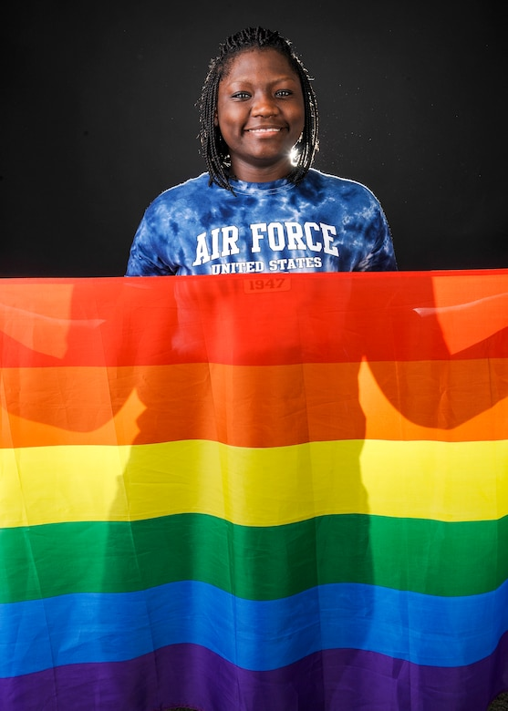 Airman 1st Class Celeste Smith, 354th Comptroller Squadron customer service technician, holds the rainbow flag for Lesbian, Gay, Bisexual and Transgender Pride Month June 12, 2014, Eielson Air Force Base, Alaska. Smith is an open bisexual and a member of the LGBT Pride Month committee. (U.S. Air Force photo by Senior Airman Ashley Nicole Taylor/Released)