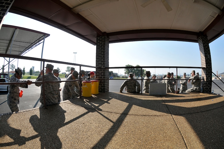MCGHEE TYSON AIR NATIONAL GUARD BASE, Tenn. - Air National Guard Airmen from across the nation take a water break here June 17, 2014, with the late morning heat index rising on the parade ground of the I.G. Brown Training and Education Center. The Airmen are students in satellite Airman Leadership School and performed their summative evaluation for drill and ceremony. (U.S. Air National Guard photo by Master Sgt. Mike R. Smith/Released)