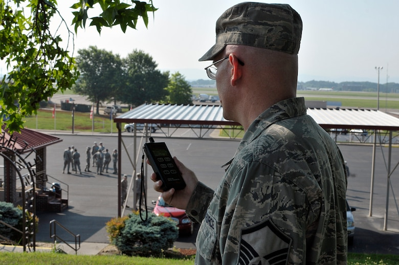 MCGHEE TYSON AIR NATIONAL GUARD BASE, Tenn. - Master Sgt. Don Pierson, logistics manager for the I.G. Brown Training and Education Center, checks the heat index here outside the campus's parade ground June 17, 2014, while students undergo a drill and ceremony evaluation. Pierson gauges the heat index during the day to ensure service members follow safe work/rest cycles. (U.S. Air National Guard photo by Master Sgt. Mike R. Smith/Released)