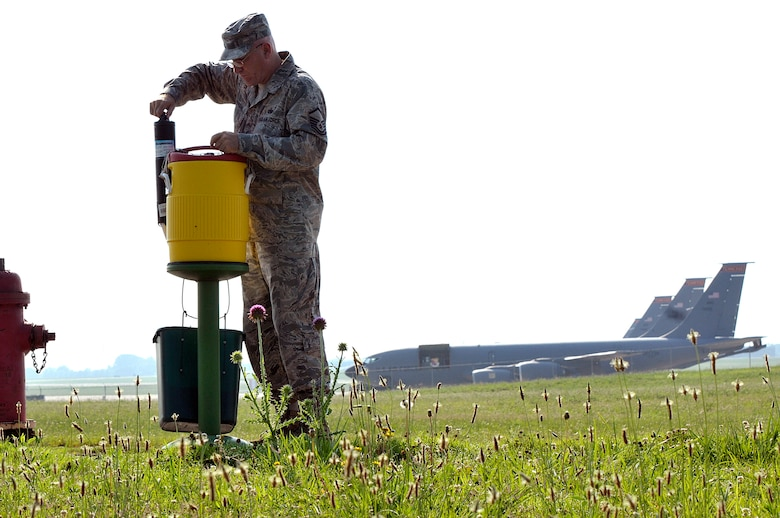 MCGHEE TYSON AIR NATIONAL GUARD BASE, Tenn. - Master Sgt. Don Pierson, logistics manager for the I.G. Brown Training and Education Center, checks the water cooler here June 17, 2014, on the base perimeter road used by runners. Pierson fills several coolers with ice and water three days a week to ensure service members stay cool and hydrated. The day's forecasted high temperature was 90 degrees. (U.S. Air National Guard photo by Master Sgt. Mike R. Smith/Released)