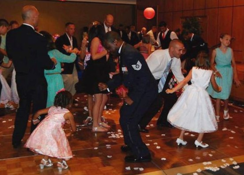 Family events, like Daddy Daughter Dances, are often held at Air Force clubs around the globe. (U.S. Air Force courtesy photo)
