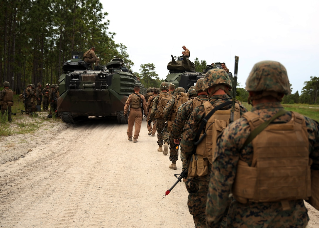 Marines with Kilo Company, Battalion Landing Team 3rd Battalion, 6th Marine Regiment, 24th Marine Expeditionary Unit, prepare to load onto amphibious assault vehicles to conduct a mechanized amphibious raid on Combat Town at Camp Lejeune, N.C., June 9, 2014. The training was part of Kilo Company's mechanized raid package in preparation for the unit's deployment with the 24th MEU at the end of the year. (U.S. Marine Corps photo by Lance Cpl. Joey Mendez)