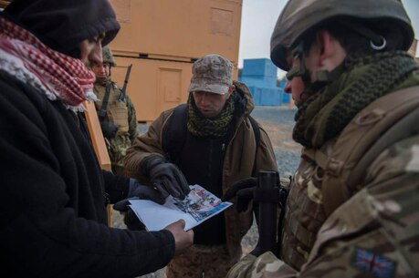 Marine Corps Information Operations Center (MCIOC), conducts training for Military Information Support Operations (MISO), at MOUT site, Quantico, Va., Feb. 11, 2014. MISO was training with actors to prepare personnel to complete future missions. (U.S. Marine Corps photo by Lance Cpl. Alexander Norred/Released)