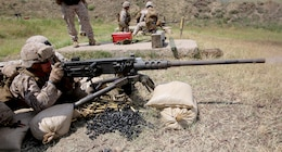 Navy Petty Officer 3rd Class James White, a corpsman with Black Sea Rotational Force 14, from 3rd Battalion, 8th Marine Regiment, accurately fires an M2 .50 caliber heavy machine gun on target during exercise Agile Spirit aboard Vaziani Training Area, Georgia, June 11, 2014. Agile Spirit 14 is an annually-scheduled multilateral engagement hosted by Georgia that began in 2011 in order to strengthen the two countries by conducting brigade and battalion-level training engagements, to include small-unit interaction between the Marines and Georgians that demonstrates their commitments toward collective, global security. (Official Marine Corps motion imagery by Lance Cpl. Scott W. Whiting, BSRF PAO/ Released)