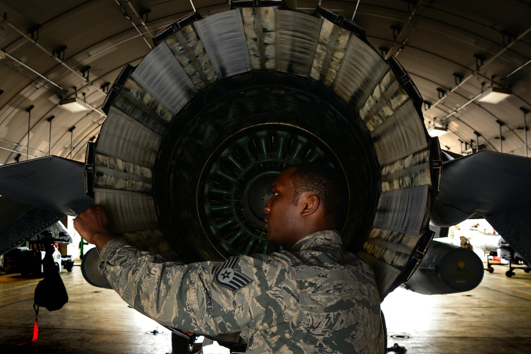 Staff Sgt. Jeremy Howard inspects the exhaust of an F-16 Fighting Falcon June 6, 2014, at Misawa Air Base, Japan. Howard is one of about 10 flightline aerospace propulsion Airmen who perform on-the-fly maintenance for F-16 engines at Misawa AB. Howard is a 35th Aircraft Maintenance Squadron aerospace propulsion craftsman. (U.S. Air Force photo/Senior Airman Derek VanHorn)