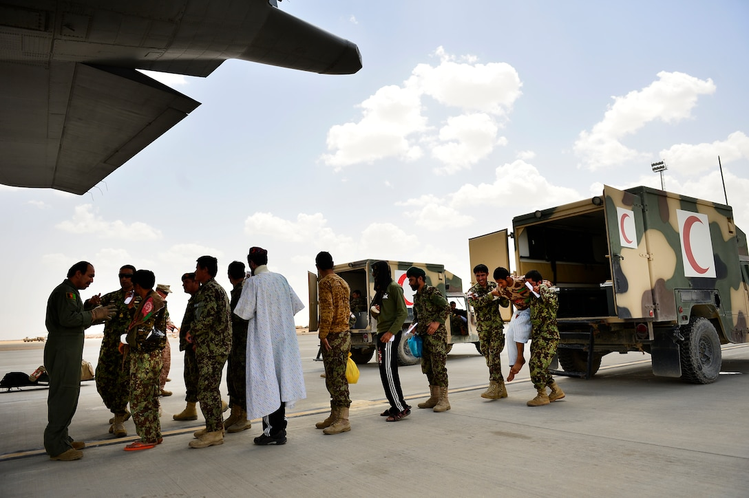 Sgt. Shanawaz Nabi Zada, an Afghan air force loadmaster, briefs Afghan national army soldiers prior to loading them on a C-130H1 Hercules May 19, 2014, on Camp Bastion, Afghanistan. As a loadmaster, Nabi Zada is responsible for briefing Afghan passengers on safety, enforcing in-flight standards and evenly distributing weight throughout the aircraft. Nabi Zada has been trained by advisors assigned to the 438th Air Expeditionary Advisory Squadron. (U.S. Air Force photo/ Staff Sgt. Vernon Young Jr.)