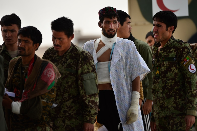 Afghan national army soldiers prepare to board a C-130H1 Hercules during a casualty evacuation mission May 19, 2014, on Camp Bastion, Afghanistan. Sixteen injured ANA soldiers were transported to receive medical care for their injuries. (U.S. Air Force photo/Staff Sgt. Vernon Young Jr.)