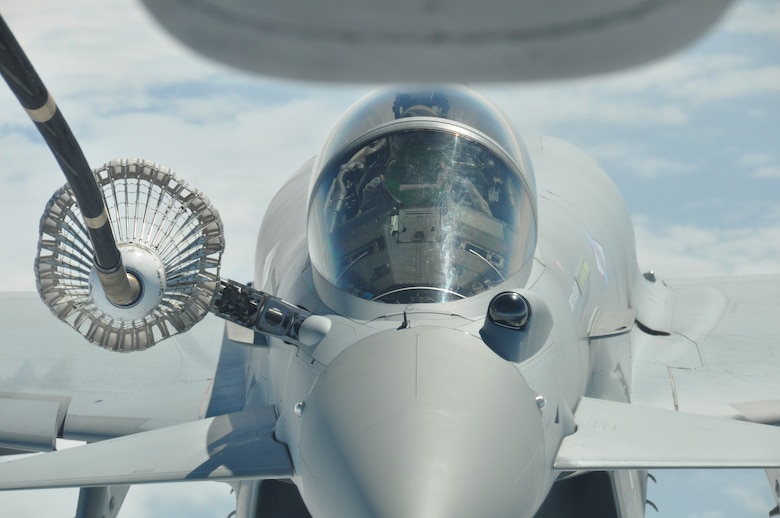 Royal Air Force pilots from the 6 Squadron flying the Eurofighter Typhoon get a rare opportunity to refuel from a KC-10 Extender piloted by Air Force Reserve aircrew stationed at Joint Base McGuire-Dix-Lakehurst, N.J, June 6, along a track near RAF Leuchars, United Kingdom. The training event took place on the 70th Anniversary of the allied invasion of Normandy, France during World War II. (U.S. Air Force photo/Master Sgt. Donna T. Jeffries)